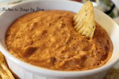 Bean Dip  16 oz. can of refried beans  1 Cup of Salsa (I always use Picante)  2 Cups of Cheddar Cheese (I prefer Sharp but will use whatever is on hand)  1 Cups of Sour Cream   3 oz. package of Cream Cheese  1 T. Chili Powder  Throw it in the crock pot and put it on high or low depending on how much time you have. Stir it every once in a while until it is all melted together. Enjoy with chips.