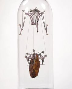 Rock Sculptures Suspended Within Bell Jars by Their Own Weight by Dan Grayber