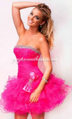 SO CUTE I LOVE THE BOW WITH THE DRESS AND IT IS PINK ............. LOVE IT