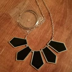 """Black statement necklace & silver hoop earrings Black statement necklace, silver chain that is 18""""w/a 2 1/2"""" extender. 1 pair of brand new silver hoop earrings, 2"""" diameter. Jewelry Necklaces"""