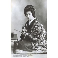 1920's. Woman in Kimono Writing. A young Japanese woman in kimono and traditional hairstyle is writing a letter or poem. This postcard was published sometime after 1918. During the early 20th century, picture postcards of bijin (beautiful women) were extremely popular in Japan (see Woman with Rose).