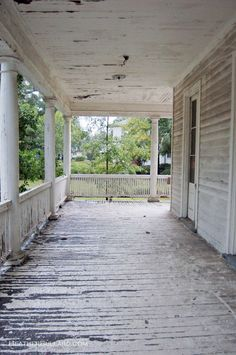 this porch is just waiting for someone to sit on it and drink some tea..and listen to all her stories