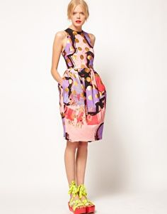 Fantastic tulip dress in spot print. Perfectly paired with eye catching neon ribbon laced around the ankles
