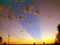 I love the colors in this display of crepuscular rays. Photo credit: Lewistown StormWatcher in Missouri.