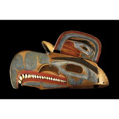 """A rare and important Kwakiutl headdress, British Columbia, Northwest Coast. According to Hawthorn (1967: 197), 'headdresses of the """"helmet"""" type, as distinguished from the chief's ceremonial dancing hats, were usually wood carvings representing family crest birds and worn on top of the head, with the button blanket completing the costume. The headdresses were held firmly in place by a ribbon or string tied under the chin, and were worn by both men and women'..."""