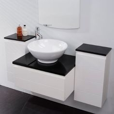 Vanity Unit Storage for Bathroom Ensuite Cloakroom - Luxury Wall Mounted Soft Closing 3 Piece Design with Black Gloss Worktop - 1 Deep Fill Drawer and 2 Cupboards - Modern Wall Hung Furniture Set in White Gloss (Dimensions - Basin Unit - Height: 310mm, Width: 600mm, Depth: 450mm ** Storage Cabinet - Height: 600mm, Width: 300mm, Depth: 220mm) Better Bathrooms ® http://www.amazon.co.uk/dp/B007BMXH5A/ref=cm_sw_r_pi_dp_ixHQvb11QXVKK