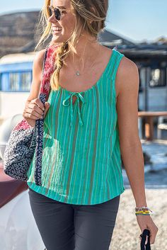 The organic cotton blended prAna Jardin top is a comfortable solid colored top with subtle style. A relaxed fit is given shape by gathering at a center slit and long ties.  #sustainable #ecofriendly #summer #organiccotton
