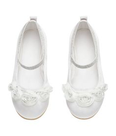 Check this out! Satin ballet flats with decorative glittery tulle flowers at front, glittery elastic strap over foot, and loop at back. Satin lining, imitation leather insoles, and rubber soles. - Visit hm.com to see more.