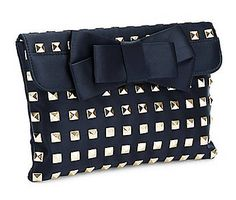 Turn heads and drop jaws with this stunning clutch from Franchi. #studs #bow