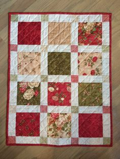"A small table mat using a Moda charm pack. From ""100 Small Quilts."""