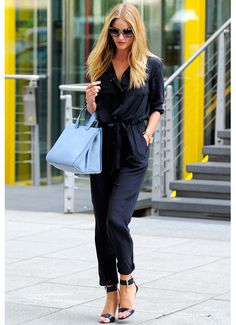 Rosie Huntington-Whiteley, street style wearing Gerard Darel black silk jumpsuit accessorized by a Giorgio Armani sky blue bag, Michael Kors black sandals and Miu Miu tortoiseshell sunglasses.