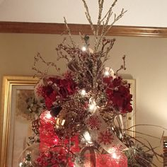 Xmas tree topper with red flowers and gold branches