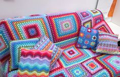 Crochet sofa throw and matching cushions from planetpenny.co.uk - so fun!