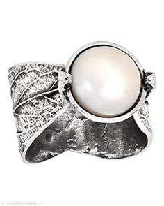 One brilliant Pearl nestled between the tips of a cast leaf. Pearl, Sterling Silver.