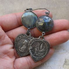 Lovely old religious medals and labradorite connectors in oxidized sterling silver create this pair of simple yet elegant earrings. Total length, including ear wires, is 2 and a half inches approx. Any question, dont hesitate to convo me. Thank you