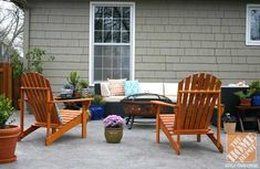 This casual but put-together outdoor living room blends a contemporary outdoor sofa with a pair of wooden stained Adirondack chairs and a freestanding fire pit! From Tobe of Because It's Awesome blog and The Home Depot Patio Style Challenge