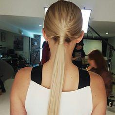 Low sleek ponytail editorial