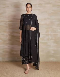Check out our Black Embroidered Chanderi Anarkali Set by BARAHMASI BY PRASHANT AND SAWRABH available at Ogaan Online store at special price. Barahmasi's simple kurta sets in soft chanderi & nakshi surface embroidery speak of refined elegance Pakistani Dresses Casual, Indian Gowns Dresses, Indian Fashion Dresses, Dress Indian Style, Indian Designer Outfits, Designer Party Wear Dresses, Kurti Designs Party Wear, Stylish Dress Designs, Stylish Dresses
