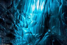 Ripples: Mr Weeratunga is among hundreds of tourists annually to brave the mass of caves in Vatnajökull, also dubbed the Vatna Glacier