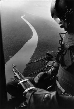 Helicopter door gunner, 1967. Photo by Gilles Caron. ~ Vietnam War