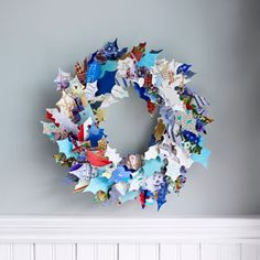These are old Christmas cards made into a wreath.  Certainly a lot of work - may be best to have an exacto knife, pad and thick cardboard tracer.