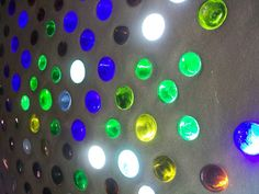 Earthship bottle wall - lets in light while keeping privacy.  The brightness, colors and design are up to you. The rooms light up with colored beams when the sun hits them directly.