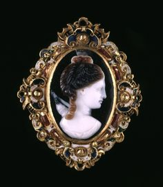 Cameo; onyx; bust of Diana to right, her bow and quiver appearing behind her shoulder; above the head is the beginning of a perforation piercing the stone and issuing beneath the bust; mounted in contemporary enamelled gold frame, protected at back by gold plate engraved with floral designs -  16thC.
