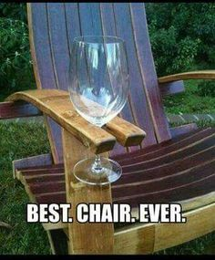 Oak barrel staves made into an Adirondack chair with wine glass holder