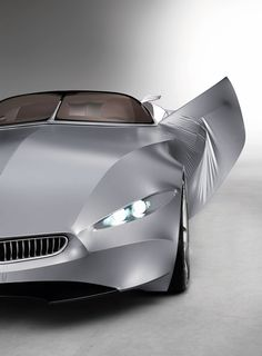 BMW Gina Concept - an innovative two-seater roadster that features a flexible and transformable outer skin made of special fabric material stretched across a moveable metal structure.