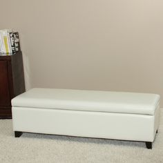 This ivory bonded leather storage ottoman bench features hidden storage space that you can easily access by just lifting the top of the bench. Its hardwood frame is designed for durability, and its soft, upholstered leather is made for comfort.