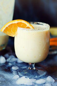 Mango banana smoothie, made with orange juice, yogurt, honey, and ice cubes
