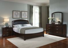 Soft clean lines, rich truffle finish with a contemporary flair.  The headboard features a subtle sleigh shape, graceful arch top and faux black leather insert.  The queen bed includes headboard, low profile footboard and siderails.  Also available in king size.