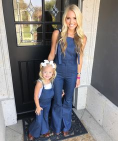 """Mommy and I wear overalls at the farm."""