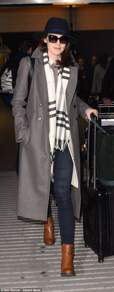 She arrived back at Heathrow on Thursday, four days before her partner's death