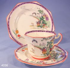 Alfred Pearce Art Deco Hand Enamelled Cottage Garden Vintage Bone China Tea  Cup, Saucer and Tea Plate Trio Pattern 5366  Lovely Tea Trio made for the London retailer Alfred Pearce around the 1920s-1930s. Hand-enamelled with dark orange flowers and finished with a dark orange trim.