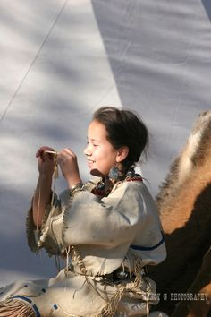 A young Native American Indian girl playing with a native primitive toy in South Dakota Native Child, Native American Children, Native American Artists, Native American History, Native American Indians, Native Americans, American Indian Girl, Indian Girls, Native Indian