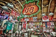 """Phillips 66″ – New Mexico    This was photographed in Northern New Mexico. The interior of this building had a lot of old #gas #station #pumps, #license #plates, neon lights, and other car themed #antiques. It is an HDR image from a combination of a number of different exposures. Photo: Matt Suess"