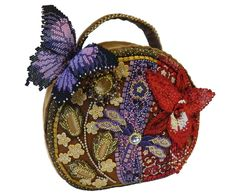 BEADED OBJECTS AND ACCESSORIES  FIRST PLACE WINNER BEST IN CONTEST RUNNER-UP PEOPLE'S CHOICE WINNER Flight Of Fancy Handbag Author: Yana Bespalaya, Kharkov, Ukraine