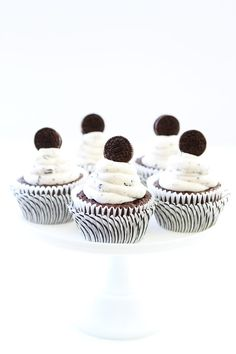 Cookies and Cream Cupcakes Recipe on twopeasandtheirpod.com Chocolate cupcakes with cookies and cream frosting and an Oreo surprise inside! They are perfect for any celebration!