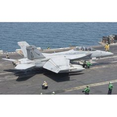 An FA-18F Super Hornet ready to launch from a catapult aboard USS Theodore Roosevelt Canvas Art - Giovanni CollaStocktrek Images (18 x 11)