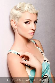 Platinum finger waves move gracefully across the crown for a look that exudes both confidence and undeniable allure.
