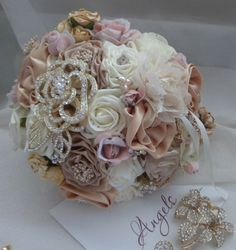 Vintage Style Soft Golds Pinks and Champagnes by AngelsWeddings    I like this but would want a strand of pearls worked in somehow and the broach not be so big (if even have one in it at all).