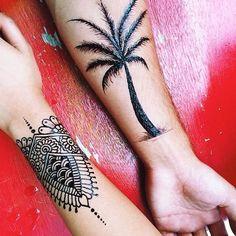 mindi and palm tree tattoo