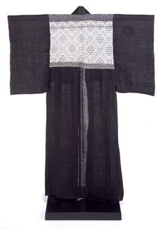 Kimono, Japan | V&A  - This kimono was made and worn by a woman living in Tsugaru, a penisula in the very north of Honshû, the main island of Japan. It is woven with fine indigo-dyed ramie. The decorative panel on the upper part has been stitched in white with a diamond pattern, a technique known as kogin. If she was to make a good marriage it was essential that a Tsugaru woman master the skills of kogin, and training began at an early age. By her wedding day the bride was expected to have wove