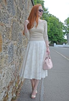 gold bardot top, white floral skirt and gold sandals
