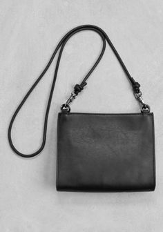 & OTHER STORIES Made from smooth leather, this mini bag has a stylishly rounded shape. - Cotton twill interior with matching leather details and small inside pocket