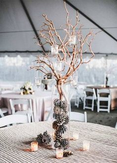 Winter wedding ideas centerpiece with pinecones and branches