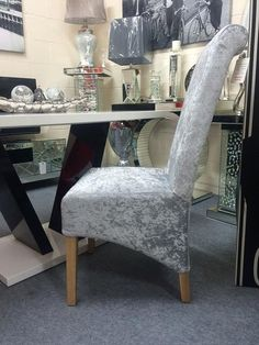 2 Silver crushed velvet dining chairs with wood leg