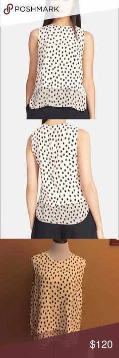 Kate Spade top ♠️ Sheer silk shirttails peek out from beneath a high-neck shell marked with playful spots inspired by the exotic snow leopard. Size XXL, equivalent size 14. Length 26 inches.  100% viscose top layer, 100% silk bottom layer. Dry clean. By kate spade new york; imported. New with tags, great buy! Retail $228. kate spade Tops Blouses