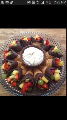 Fruit in chocolate dipped ice cream cone. Cute way to serve!